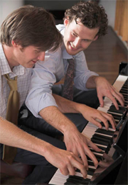 2 Piano players performing