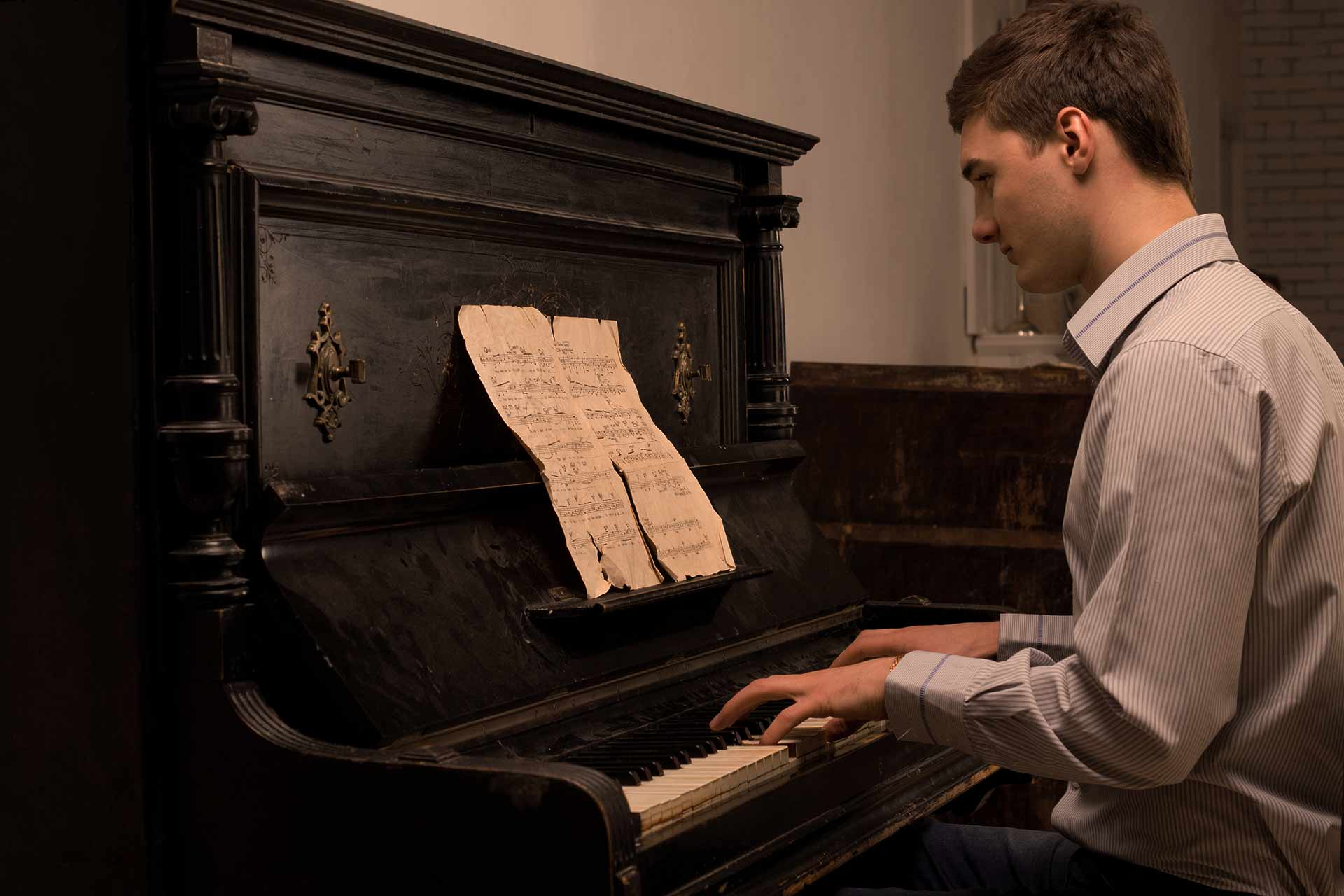 Gentleman reading a piano score