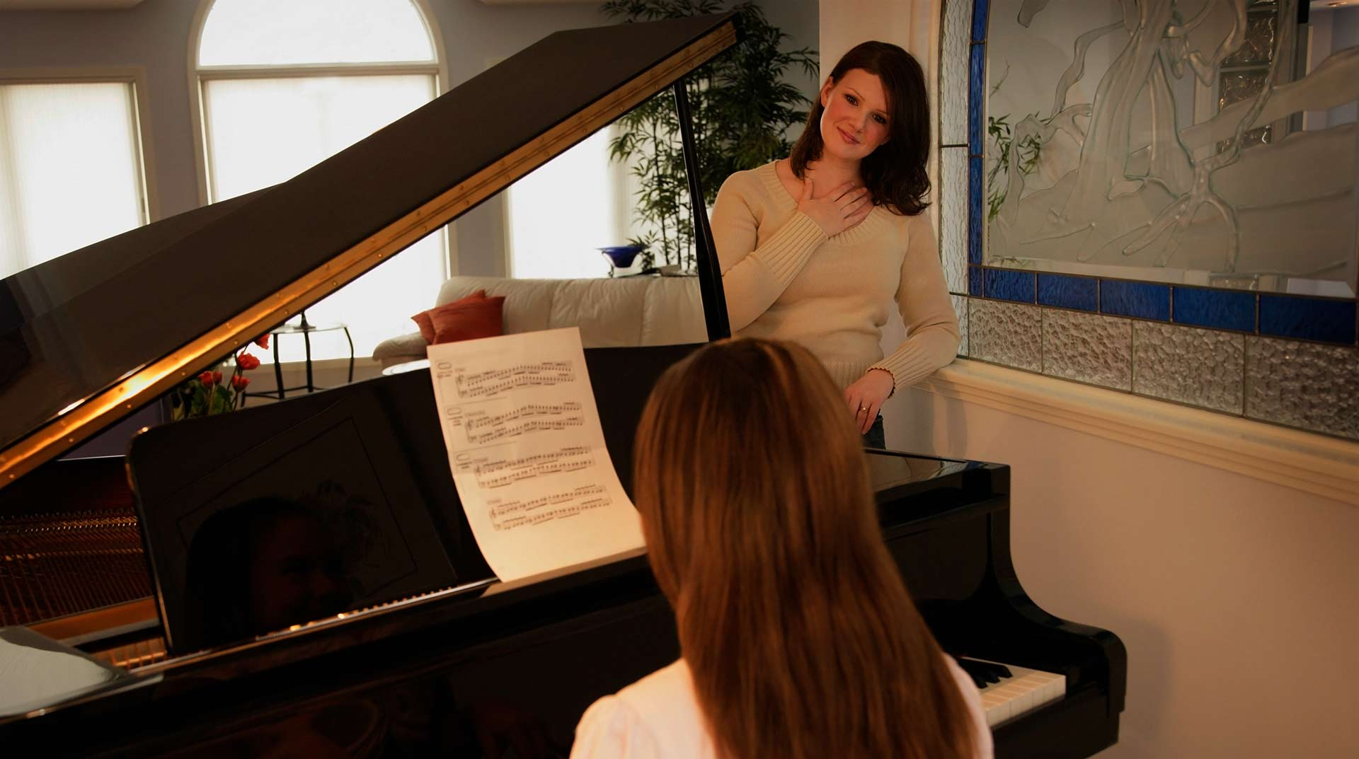 Piano teacher with her student