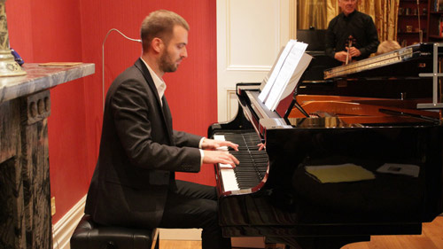 Adult taking piano lessons in London