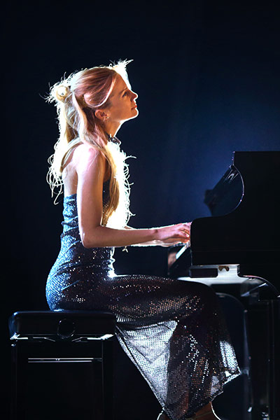 Lady playing on a grand piano