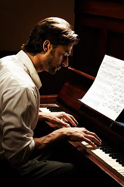 Gentleman playing the piano