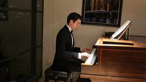 Alex performing at the Spring 2015 Secret agent concert at the London Piano Institute