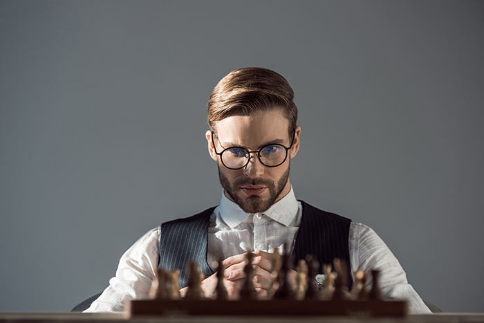 Intelligent man playing chess