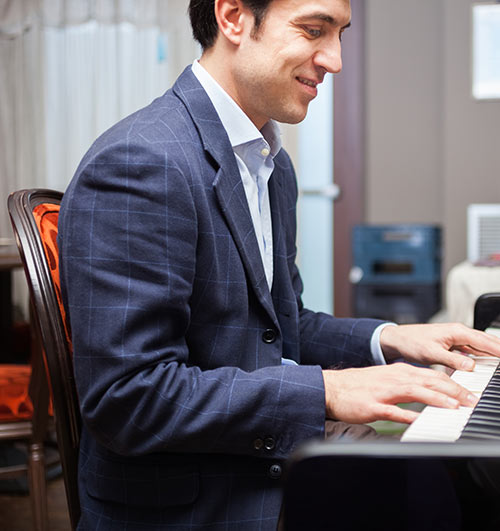 Man learning how to play jazz piano
