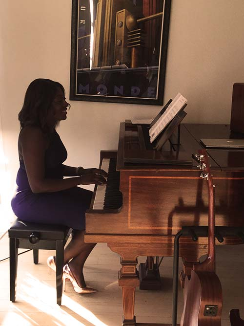 Tasha performing the piano