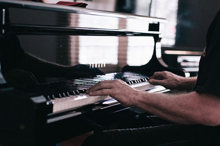 Guy playing a grand piano