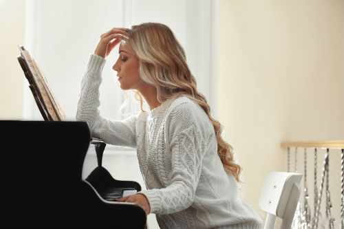 Lady sight-reading a musical score