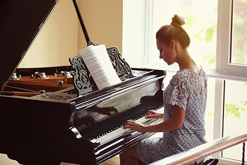 a woman performing the piano