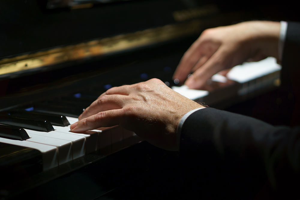 Man's hand on the piano