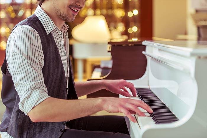 Man playing rock and roll piano