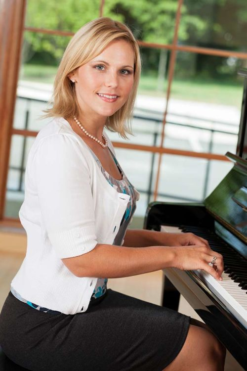 Woman learning to play the piano