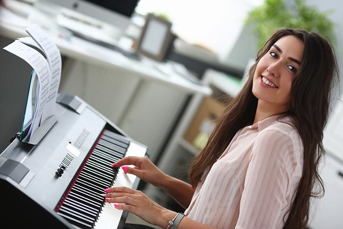 Lady teaching herself the piano