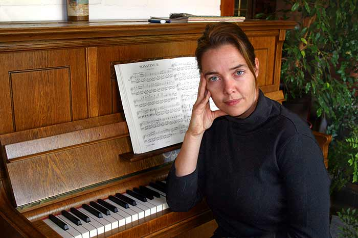 Lady preparing for her piano examination