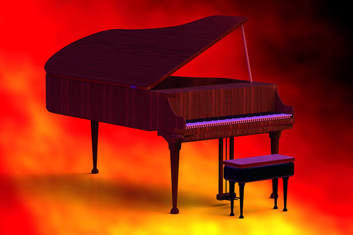 Grand piano on red background