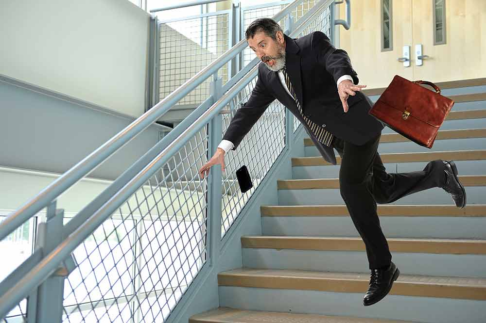 Man falling in stairs