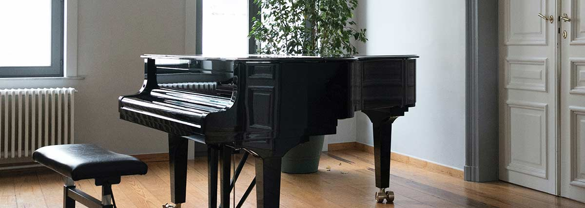 grand piano inside a room