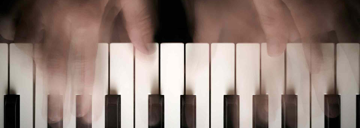 piano keys with blurred hands