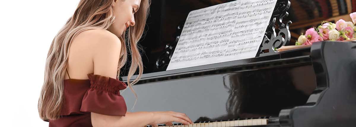 beautiful-woman-practicing-the-piano