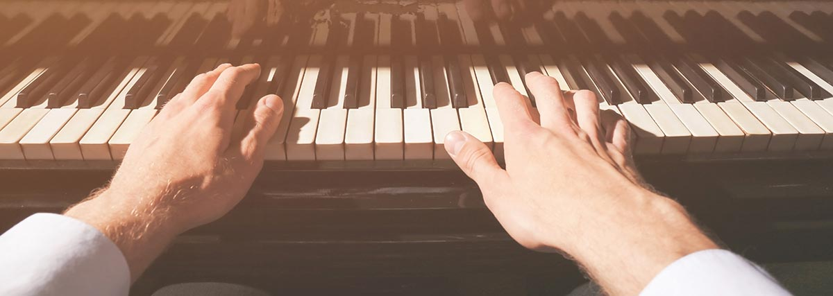 Close up hands on the piano