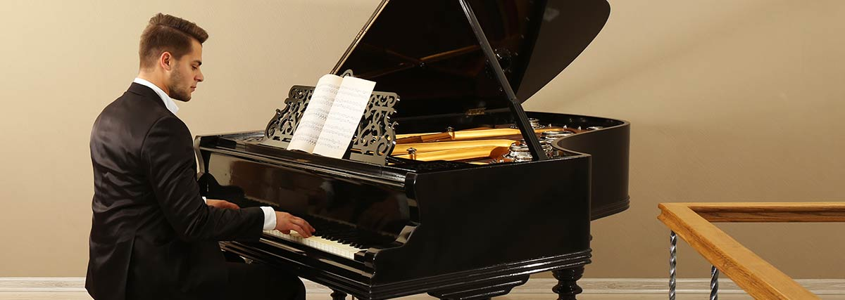 Man practicing the grand piano