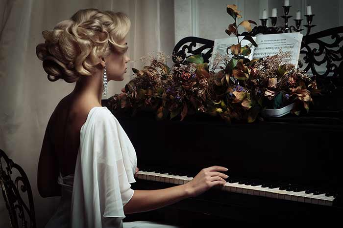 woman-in-white-playing-the-piano-feat