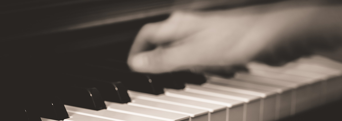 blurred hand on the piano
