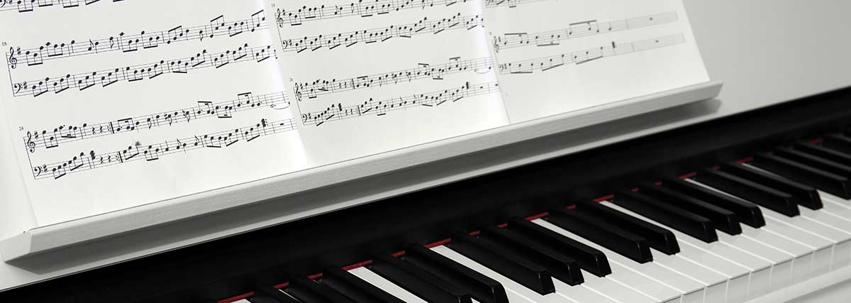 music sheet on the piano