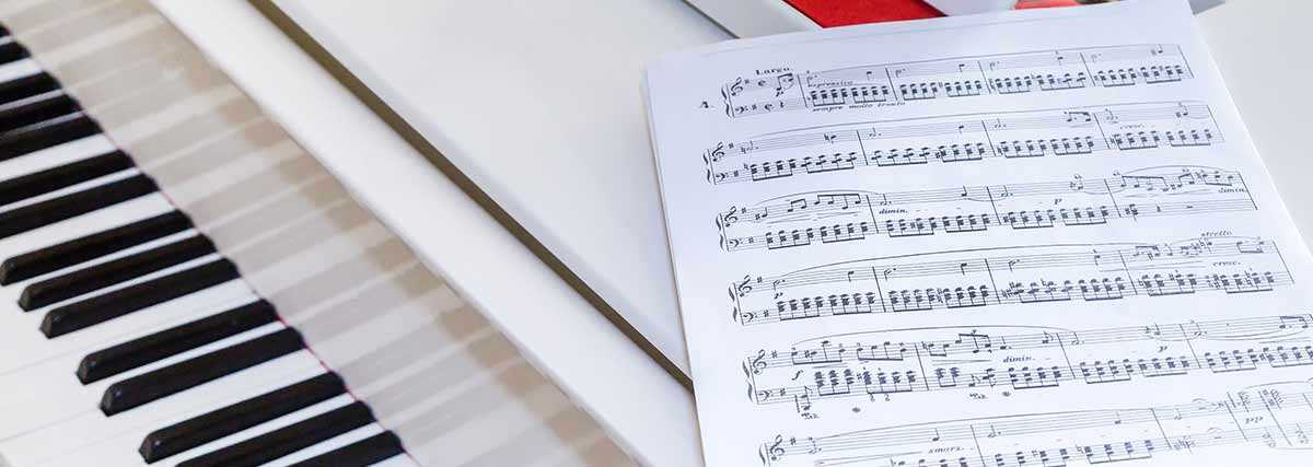 music sheet on top of the grand piano