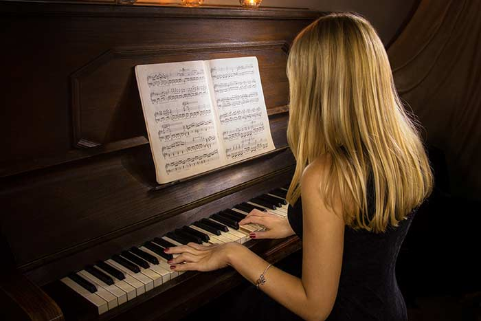 woman playing the piano feat