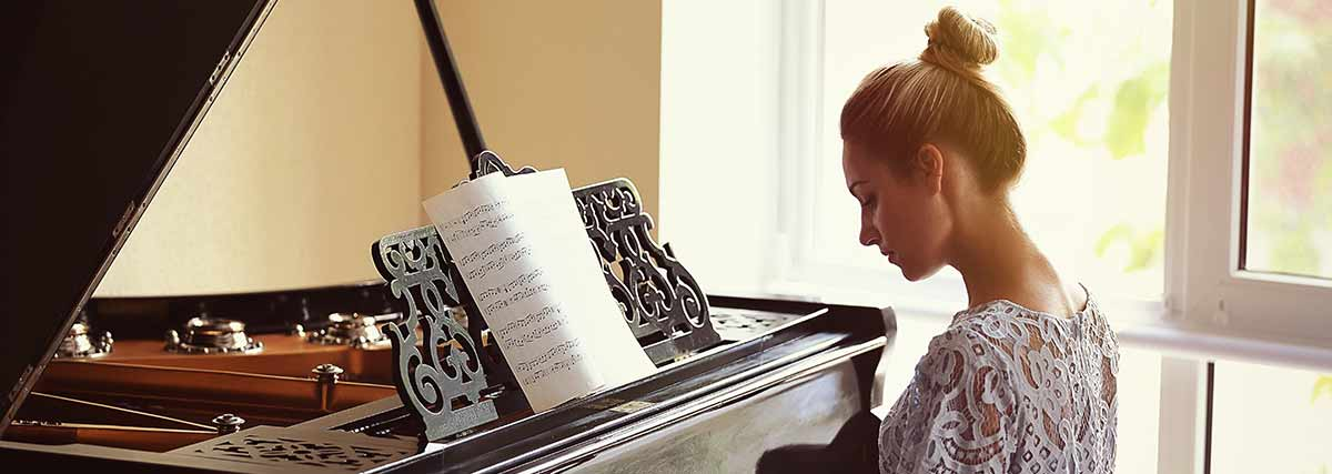 woman practising the piano
