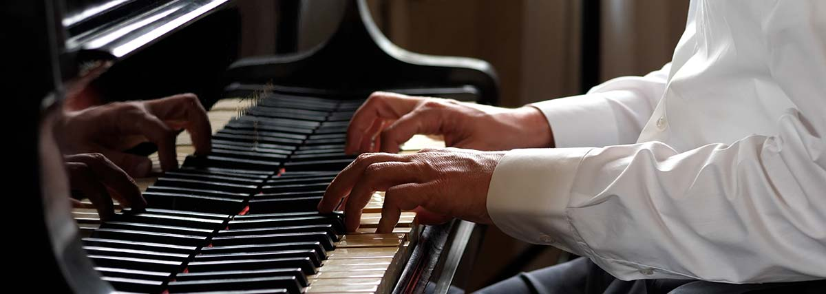 hands playing on the piano