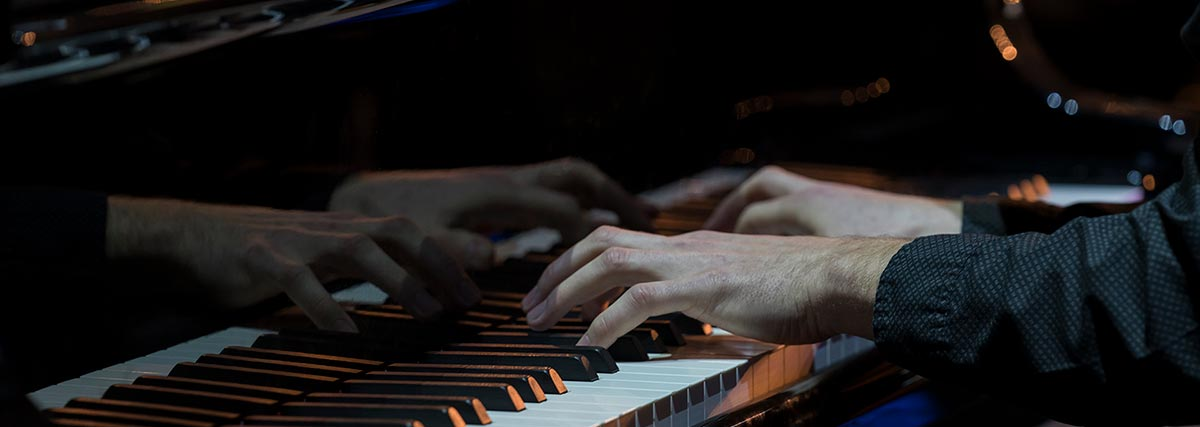 hands playing the grand piano