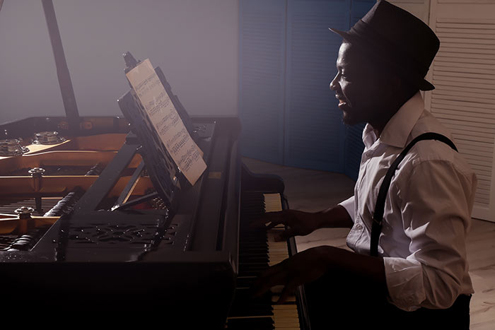 man playing on the grand piano feat