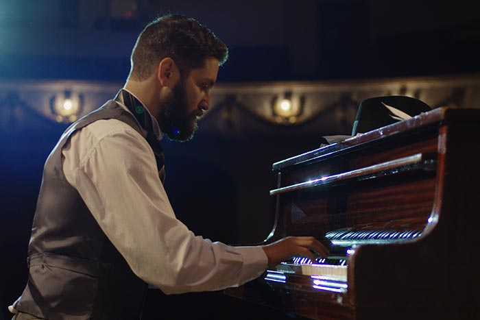 pianist performing on stage feat