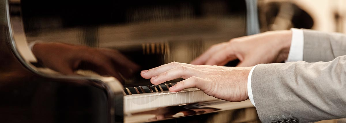 pianist performing on the piano