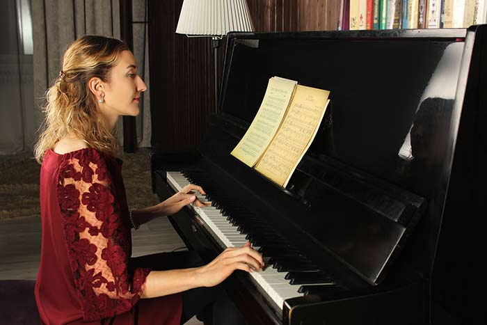 woman reading piano music feat